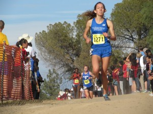 Junior Fiona O'Keeffe races to a first place finish at the CIF Cross Country State Championships on Nov. 29.