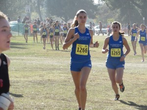 Sophomore Sofia Castiglioni and junior Jasmine Casillas stride out at the start line before the race.