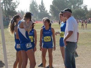 The women's varsity team prepares for the race with coach Bill Gregg.