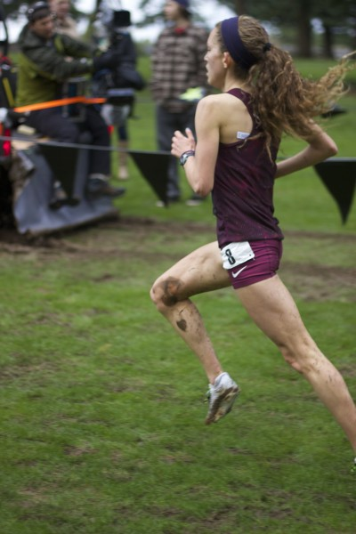 Fiona O'Keeffe races to a fourth place in the nation finish at the muddy Glendoveer Golf Course on Dec. 6.