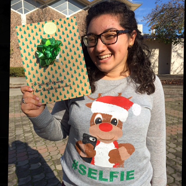 Student Government granted Danielle Newman her wish for an ugly Christmas sweater! (Photo: E. Lufburrow)