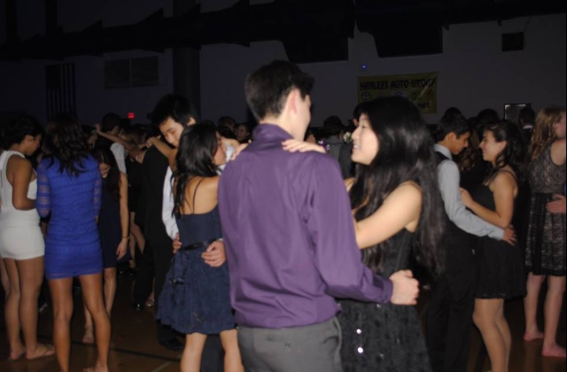 Sophomore Kyle Qi dances with junior Margaret Ji during Winter Ball.