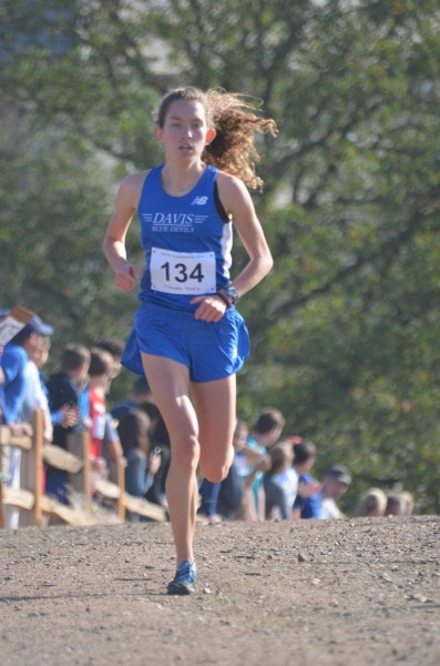 Junior Fiona O'Keeffe races to her third section title and a new course record on Saturday, Nov. 15 of last year.