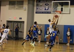 Varsity men's basketball makes second half comeback win over Grant