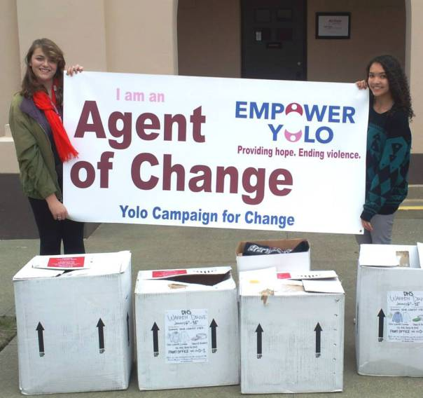 "Feminism Club officers Claudia Shebloski and Noelle Averett organized ""Warmth Drive"" donations for Empower Yolo in 2014. This year, the ""Supply Drive"" focuses on collecting items for the organization's emergency shelter. Courtesy photo by Davis High Feminism Club."