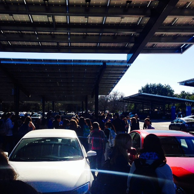 Unexpected fire alarm causes everyone to migrate towards the Vets memorial center. (Photo: B. Potoski)