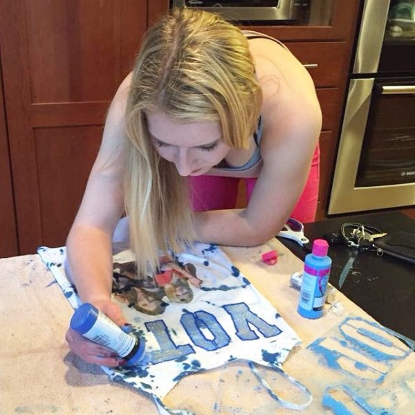 Senior class president candidate Elsa Iverson decorates Tshirts to prompthellip