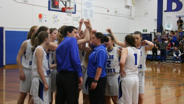 The Blue Devils rally together before the start of the second half. The score at the end of second quarter was  50-27, with the Blue Devils ahead.