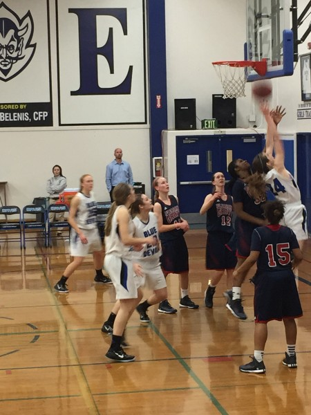 Senior Emma Stenz makes one of her many layups on the way to a 54-46 victory over visiting Pleasant Grove. Photo by Kellen Browning
