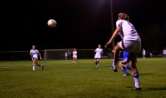 Senior Kasey Carlson passes the ball upfield to a fellow Blue Devil.