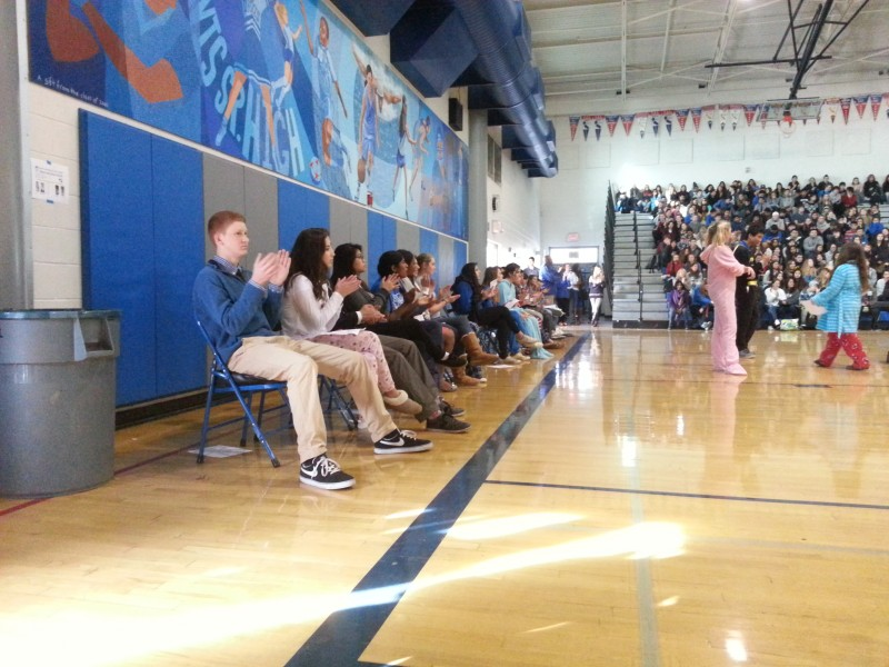 The student government candidates take turns speaking to the sophomore and junior classes in the North Gym.
