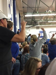 The packed South Gym crowd goes wild during overtime.