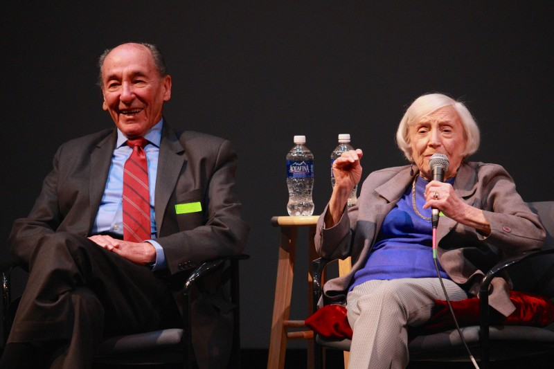 World War Two spy Marte Cohn speaks to a packed Brunelle Theater audience as her husband looks on. Photo by Riley Donahue.