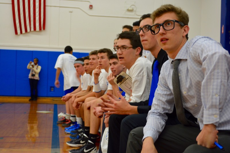 Co. coach Glen Welch, and his team watch attentively from the sidelines. Photo by Bryanne Potoski.