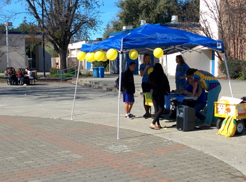 Members of student government set up a tent and speakers for the balloon stomp, which was the final event of Week of Kindness.