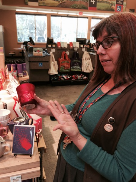 Co-op's Marketing Director Julie Cross displays their unique Valentine's Day gifts that range from butterfly wax candles (shown above) to chocolate truffles with edible wrappers.