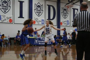 Senior Emma Stenz moves in to block a Grant Pacer. The Blue Devils pulled a 72-59 win to remained undefeated in their league.