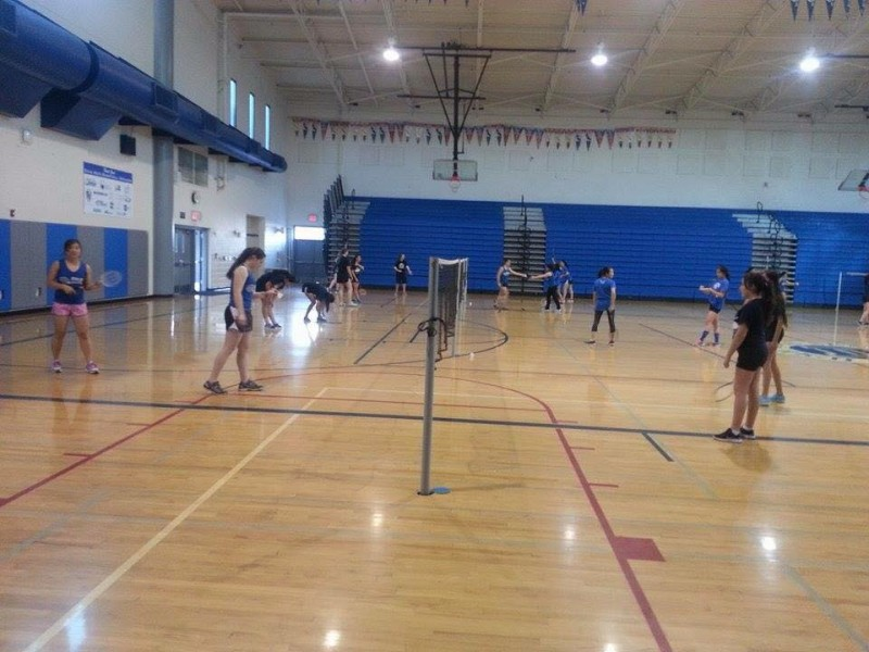 The women's badminton team warm's up for their home match against Napa.  Courtesy Linda Li