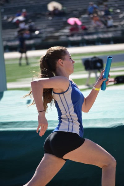 Junior Elizabeth Salomon races the fourth leg for the 4x200 meter relay at the Sac State Track Classic Invitational. The women's team placed third overall with a time of 1:52.39 seconds. Courtesy photo by Elizabeth Salomon