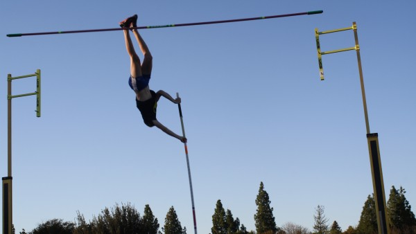 Senior Nate Harper tries to clear the pole vault at a meet earlier this year. Harper vaulted 14' to win on April 8. Photo by Zoe Vikstrom.