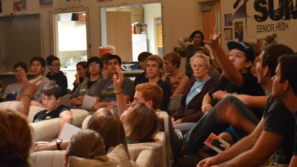 High school students settle down in the youth room at University Covenant Church on Tuesday Oct. 14. After a short activity or game, students took part in worship, listened to a sermon, and then had time to chat with friends at the end of the night.
