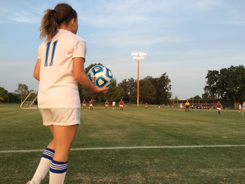 Junior Hannah DeKnikker examines the field as her team plays Edison High. The Blue Devils defeated the Vikings, 14-0.