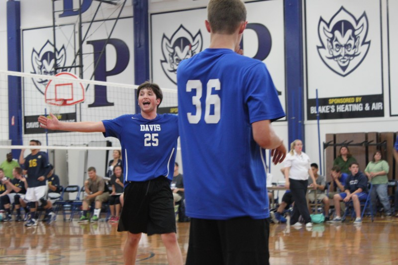 Volleyball captain Evan Meerscheidt motions to the crowd during a 2014 game. Meerscheidt decided not to continue volleyball collegiately.