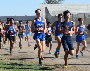 Cross-country runners race at the Pacific Tiger Invitational earlier in the season. Top members of the team will be unable to attend the Homecoming game due to the Clovis Invitational.