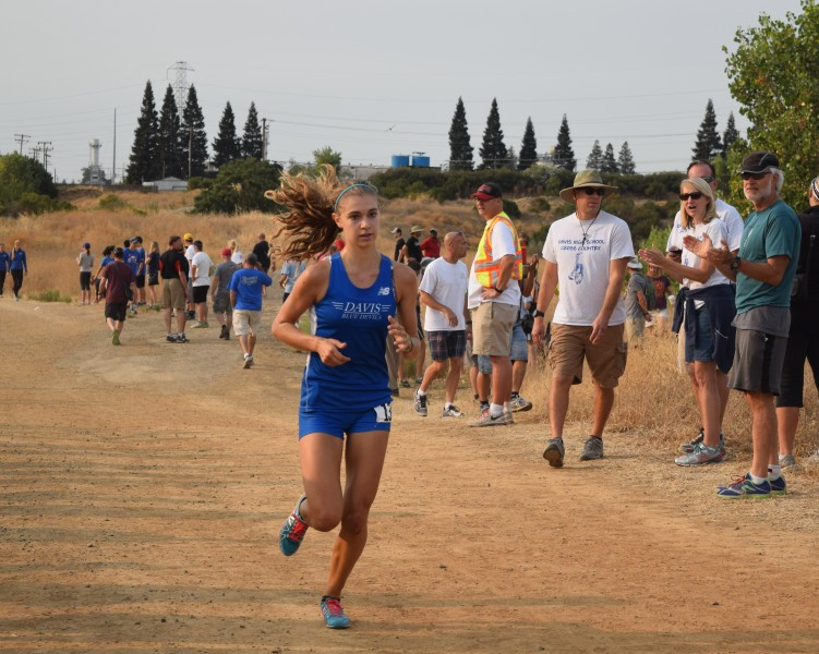 Junior Sofia Castiglioni runs to a third place finish in the womens varsity race at Granite Regional Park.