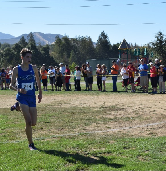 Junior Michael Vernau sprints into finish first in the varsity race with a time of 15:12 for three miles.