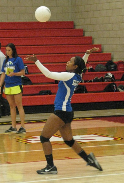 Freshman Maraia Tuqiri serves the ball, to be received and rallied by St Francis, in the first game.