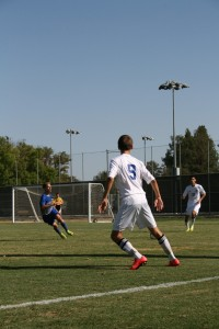 Junior Kyle Cuvelier prepares to kick the ball in the Blue Devils' 1-1 tie with Rocklin High School.