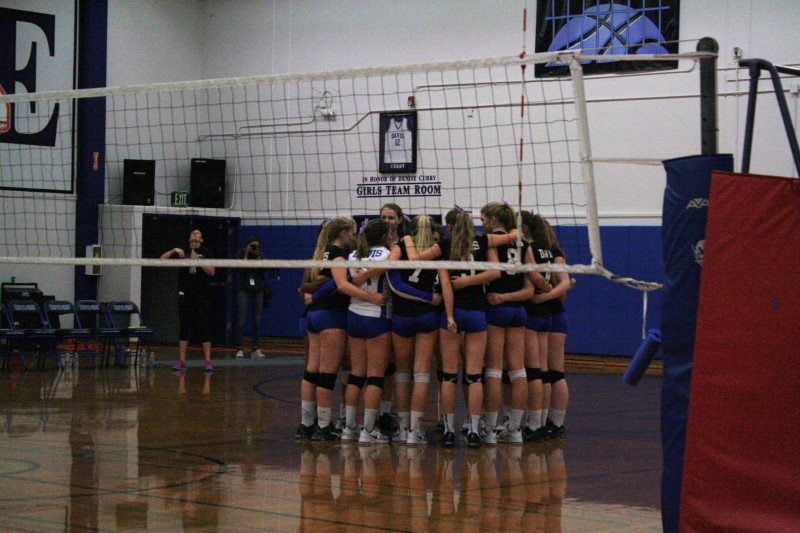 Davis High women's Volleyball team huddles during their time out