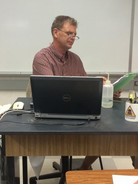 Chemistry teacher David Van Muyden logs his students' grades online using School Loop.