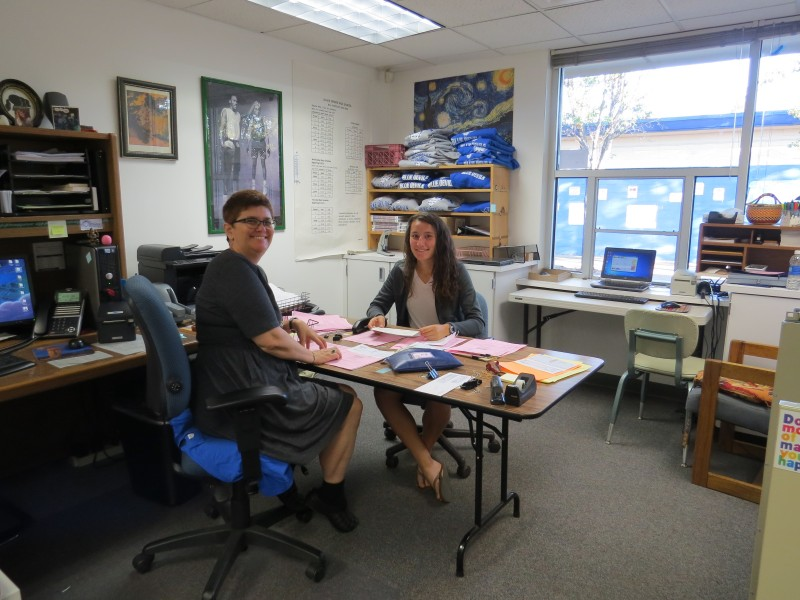 Senior Isabella Babich and Cheryl Ozga work together to count money and input checks.