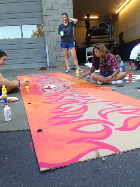 DHS juniors build parts of their float at Goodyear in Davis during Homecoming week.