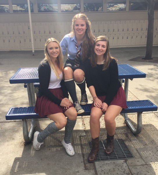 Seniors Kadence Waggoner, Bay Warland, and Emma Kaplan dress up for put a little prep in your step Thursday. (Photo by W Sacramento)