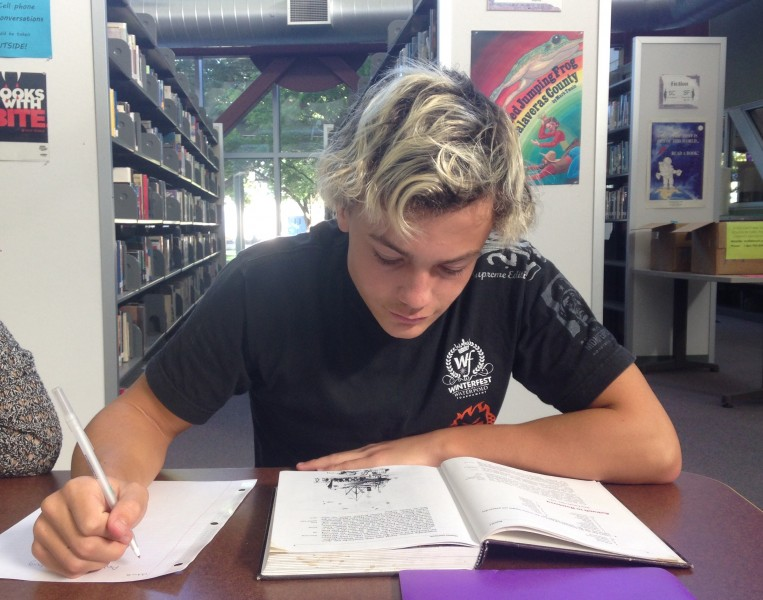 Junior Peter Blumberg works on an assignment for his German 4 Honors class. German is a large part of Blumberg's life.