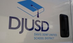 The Davis Joint Unified School District Logo is pictured on a truck, parked at the DJUSD Operations center.