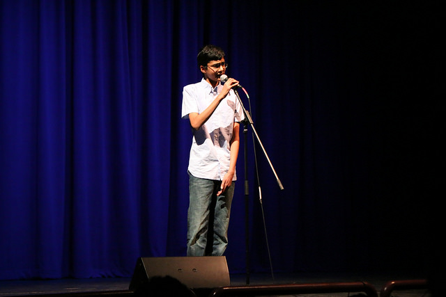 """Sophomore Abhi Vemulapati, winner of the 2015 DHS Factor, stunned the audience with his voice while singing """"Thinking Out Loud"""" by Ed Sheeran. The talentcomes naturally to Vemulapati, who heard about the competition last minute and chose a Karaoke song to sing. (Photo: A. Manzanilla)"""