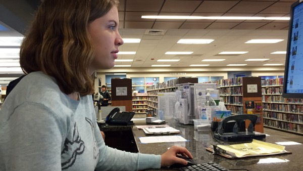 Senior Claire Drown works at the computer help desk at the Yolo County Library.