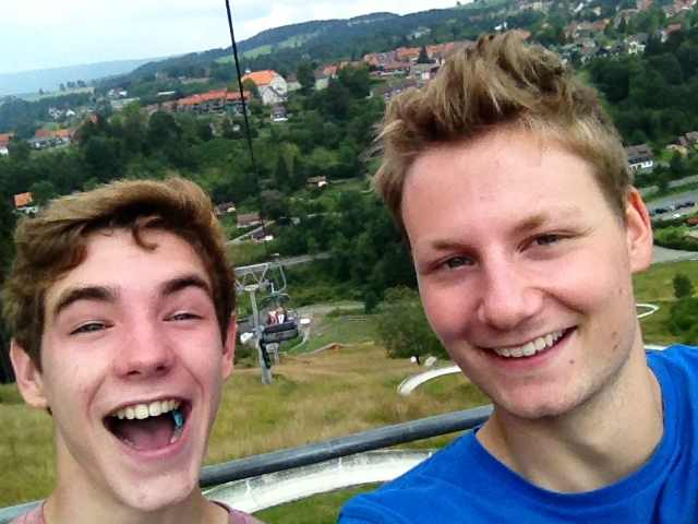 Junior Jonathan Lovely and exchange student Paul enjoy the view from a ski lift.