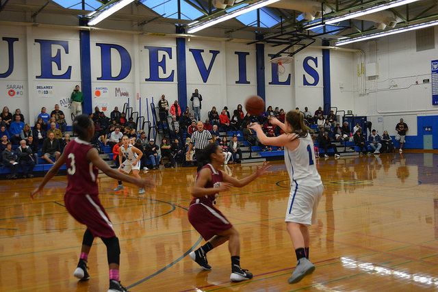 Sophomore Kelsey Forrester passes to senior Anna Belenis in an earlier game this season. Forrester had 13 points on Wednesday.