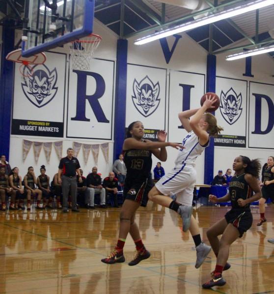 Junior Alyssa Lengtat shoots the ball in DHS' loss to Salesian on Friday, Dec. 4.