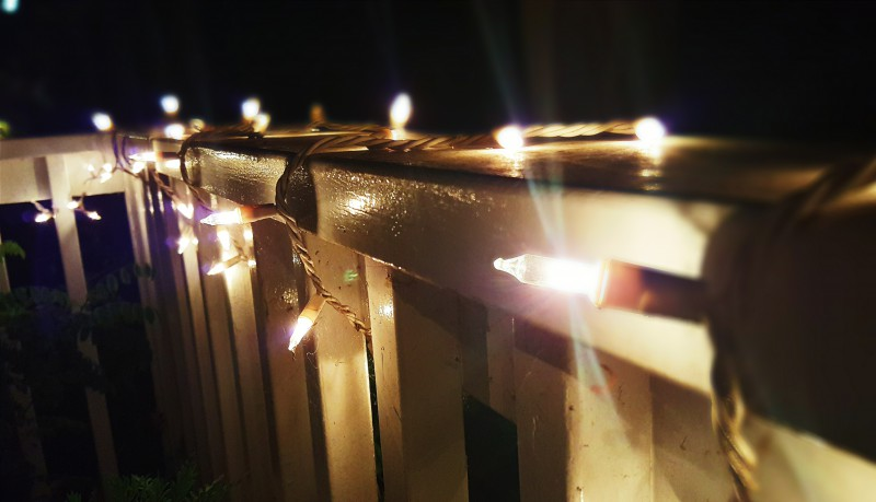 Hyo Joon Ahn's balcony fence is wrapped in incandescent lights.