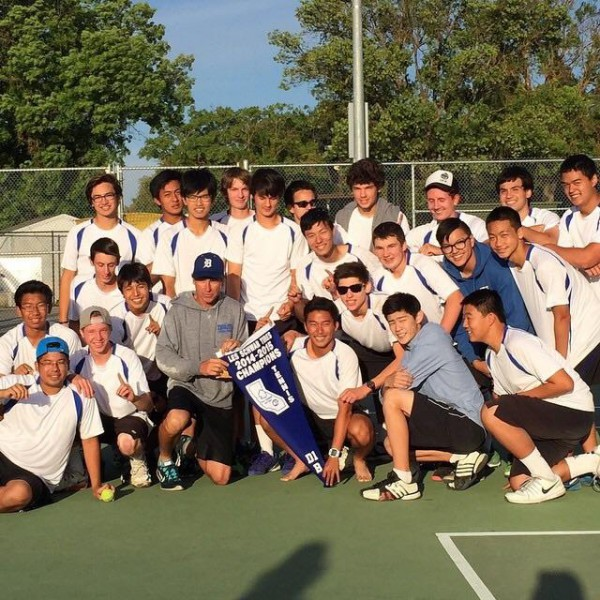 Sophomore Young Shim poses for a picture with the team after winning sectionals last year.