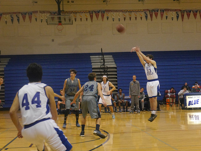 Senior Ben Prussel shoots a 3-pointer in a game earlier this season.