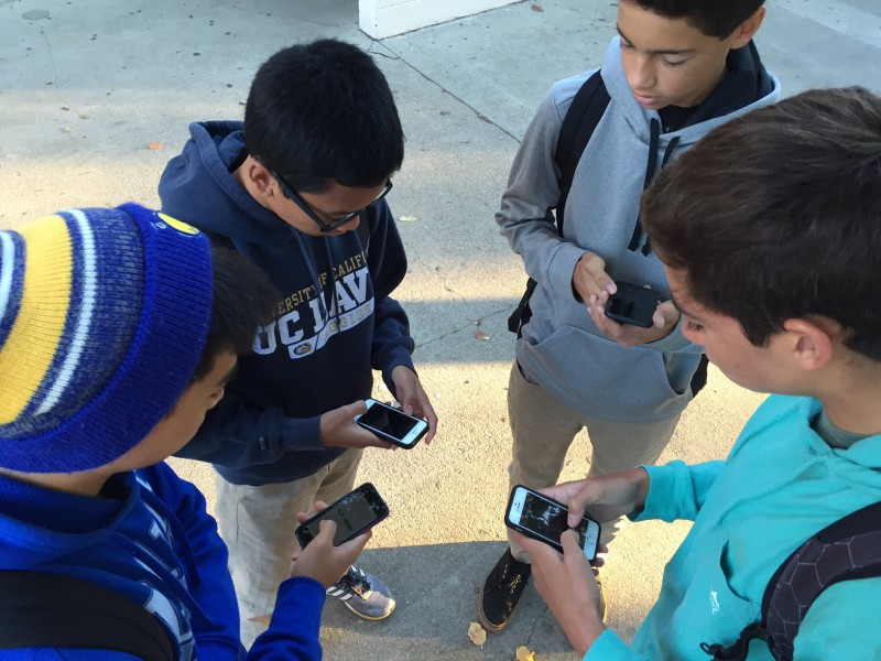 From left to right sophomores Ace Gimenez, Tommy Aquino, Kailas Dhond and Jake Taylor discuss fantasy sports during lunch time on the DHS.