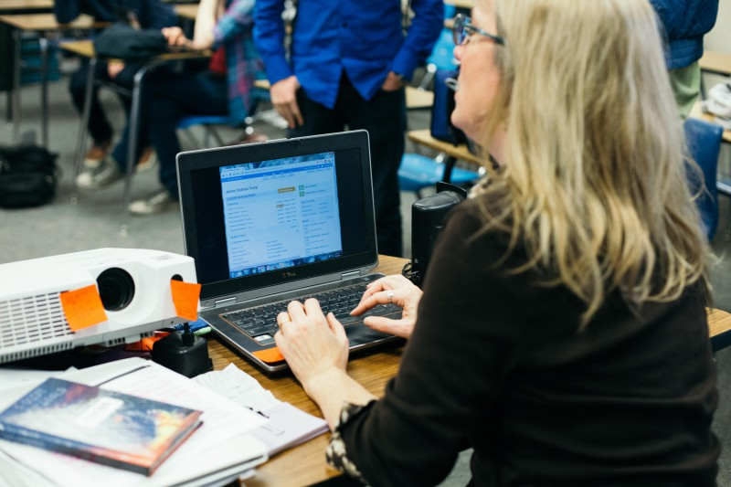 English teacher Janine Widman works on her New Year's Resolution of updating School Loop more often. (Photo: M. Bobrowsky)