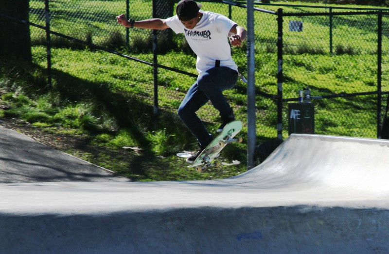 Thompson performs a jump off the ramp at the skate park near DHS.